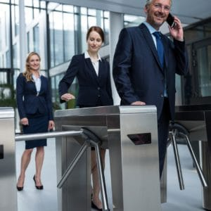 Access Control - businesspeople scanning their cards at turnstile gate 300x300