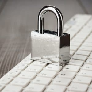 Other Solutions - padlock and white computer keyboard on the wooden office table 300x300